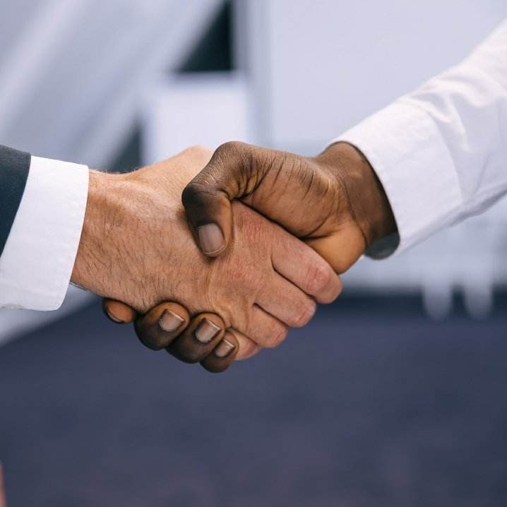 two men shaking hands multicultural